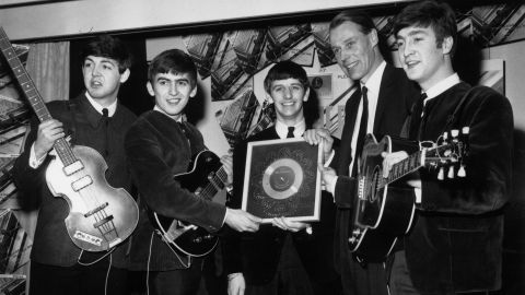 """<a href=""""http://www.cnn.com/2016/03/09/entertainment/george-martin-obit/index.html"""">Sir George Martin</a>, the music producer whose collaboration with the Beatles helped redraw the boundaries of popular music, died March 8, according to his management company. He was 90. Above, Martin poses with the Beatles after the album """"Please Please Me"""" went silver in 1963."""