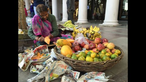 """INDIA: """"An elderly street vendor in New Delhi is seen talking on a smartphone. Home to a population of almost 1.3 billion people, India is already the world¹s third largest market for smartphones."""" - CNN's Harmeet Singh @harmeetshahsingh."""