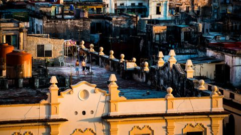 The sun sets on the rooftops of the Old City. Eighty percent of the buildings in Havana were constructed between 1900 and 1958, before the American embargo took effect. Many are now in urgent need of repair.