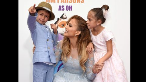 """Jennifer Lopez, son Max and daughter Emme attend the premiere of """"Home"""" last year. The singer is proud her twins are bilingual thanks to her nanny who speaks to them in Spanish."""