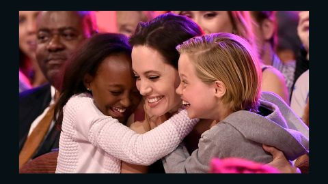 Actress Angelina Jolie hugs Zahara Marley Jolie-Pitt and Shiloh Nouvel Jolie-Pitt. The Jolie-Pitts children speak French as a second language at home.