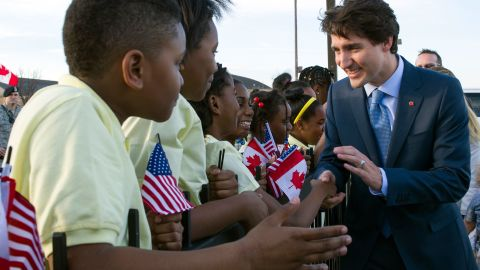 Trudeau greets students from Washington's Patterson Elementary School after he arrived at Andrews Air Force Base in Maryland on Wednesday, March 9.