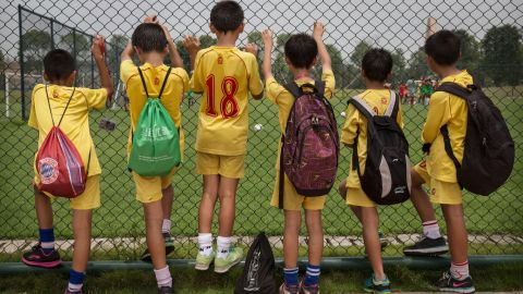 """""""I hope to make it into the national football team and then make it into the Spanish clubs like Barcelona and Real Madrid,"""" 14-year-old pupil He Xinjie told CNN."""