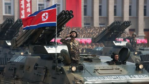 A North Korean soldier salutes from a tank during a military parade past Kim Il-Sung square marking the 60th anniversary of the Korean war armistice in Pyongyang on July 27, 2013.  North Korea mounted its largest ever military parade on July 27 to mark the 60th anniversary of the armistice that ended fighting in the Korean War, displaying its long-range missiles at a ceremony presided over by leader Kim Jong-Un.  AFP PHOTO / Ed Jones        (Photo credit should read Ed Jones/AFP/Getty Images)