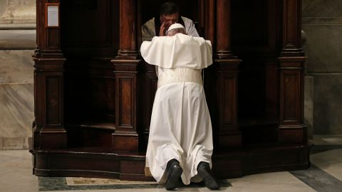 Pope Francis confesses in St. Peter's Basilica during the Vatican's Penitential Celebration on Friday, March 4, 2016.
