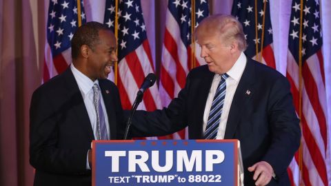 Republican presidential candidate Donald Trump stands with former presidential candidate Ben Carson as he receives his endorsement at the Mar-A-Lago Club in Palm Beach, Florida on March 11.