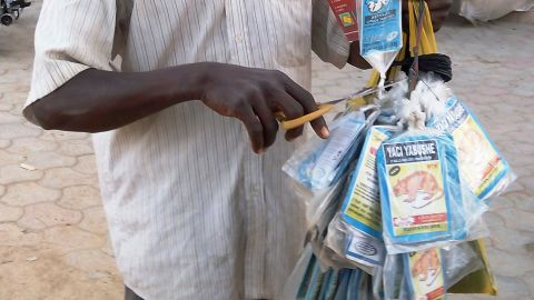 """TO GO WITH AFP STORY BY AMINU ABUBAKAR A vendor sells bags of rat poison in northern Nigeria's largest city of Kano on January 18, 2016. Sales of rat poison have taken off in Nigeria following an outbreak of Lassa fever that has left at least 76 people dead and sparked fears of contagion across the country. In the northern city of Kano, the capital of one of 17 states where the haemorrhagic virus has been recorded, there have been """"unprecedented"""" purchases of the pest control product. / AFP / AMINU ABUBAKAR        (Photo credit should read AMINU ABUBAKAR/AFP/Getty Images)"""