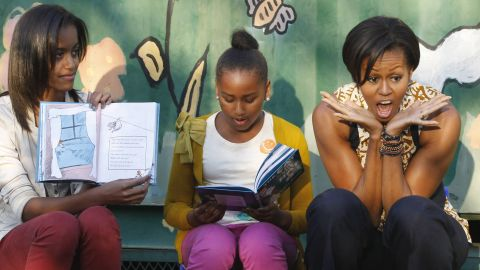 The first lady and her daughters read to children as they visit a community center in Johannesburg in June 2011.