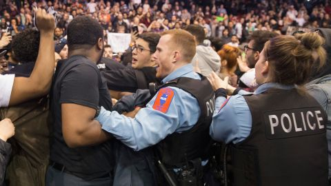 CHICAGO, IL - MARCH 11:  Police break up skirmishes between demonstrators and supporters of Republican presidential candidate Donald Trump that broke out after it was announced a rally at the University of Illinois at Chicago would be postponed on March 11, 2016 in Chicago, Illinois. The campaign decided to postpone the rally, citing safety concerns, after learning hundreds of demonstrators were given tickets for the event.  (Photo by Scott Olson/Getty Images)