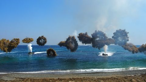 """Clouds of camouflage smoke obscure amphibious assault vehicles coming into shore as part of military exercises on March 12.  South Korea's defense ministry spokesman is calling the maneuvers """"the largest scale ever,"""" involving 300,000 South Korean soldiers and at least 17,000 from the U.S."""