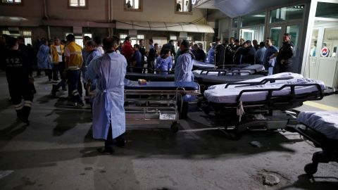 Paramedics wait outside the Ankara Numune Hospital to assist with victims of the explosion.