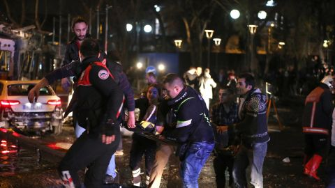 Rescuers carry a victim on a stretcher at the scene of a blast in Ankara on March 13, 2016.At least 27 people were killed and 75 others wounded in a blast in the heart of the Turkish capital Ankara, local media reported, speaking of an attack. Ambulances rushed to the scene of the explosion on Kizilay square, a key hub in the city, and television pictures showed burnt-out vehicles including a bus. / AFP / ADEM ALTAN        (Photo credit should read ADEM ALTAN/AFP/Getty Images)