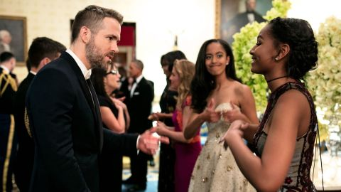 """Malia Obama offered some sisterly support as Sasha Obama talked to """"Dead Pool"""" star Ryan Reynolds."""