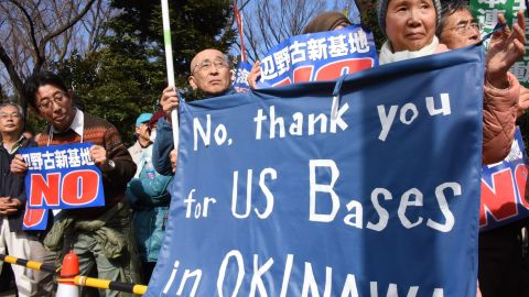 Demonstrators protest the construction of a U.S. Marine air base in the remote Henoko part of Okinawa island, to replace the existing Futenma facility, in front of the National Diet in Tokyo on February 21, 2016.