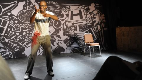 """In 2013 actor Inua Ellams performed """"The 14th Tale"""" at the Lagos Theater Festival. The production was a free flowing narrative about the funny exploits of a natural born mischief, growing from the streets of Nigeria to the roof tops of Dublin, and finally to London."""