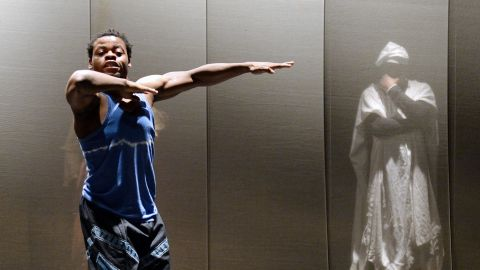 """Nigerian dancer and choreographer Qudus Onikeku (left) and Cameroonian actor Emil Abossolo perform a scene of Onikeku's creation """"Qaddish"""" at the Salle Benoit XII in Avignon, as part of the 67th international theater festival."""