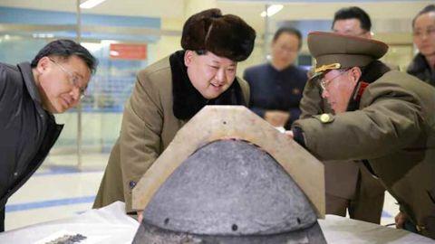 North Korean leader Kim Jung-un reviewing a ballistic rocket simulation.