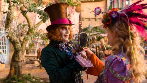 """Alice (Mia Wasikowska) is back in """"Alice Through the Looking Glass,"""" the sequel to 2010's """"Alice in Wonderland."""" Also back: Johnny Depp as the Mad Hatter, Tim Burton as the director and Lewis Carroll as the British author on whose works the films are based. It opens May 27."""
