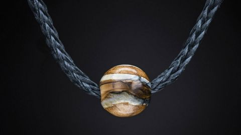 """The bead on this bracelet, from Portland-based design company William Henry, is actually <a href=""""http://edition.cnn.com/2016/03/29/luxury/dinosaur-bone-accessories/"""">made</a> using fossilized mammoth tooth and dinosaur bones."""