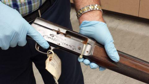 Seattle Police Detective Mike Ciesynski holds shotgun used in Kurt Cobain suicide