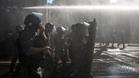 Special Forces police use water cannon to clear the Avenida Paulista, the main avenue of the city of Sao Paulo, where protesters demonstrate against the appointment of former President Lula to a ministerial position on Friday, March 18, 2016, in Sao Paulo, Brazil.