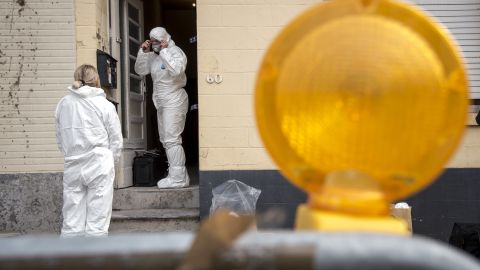 Forensics officers examine a house where Paris attacker Salah Abdeslam is thought to have hidden out