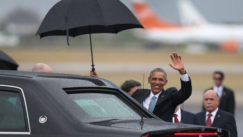 Obama waves shortly after arriving at Jose Marti International Airport.