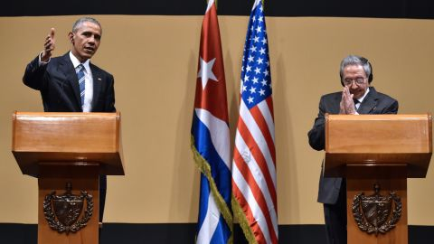 """US President Barack Obama (L) and Cuban President Raul Castro give a joint press conference at the Revolution Palace in Havana on March 21, 2016. Cuba's Communist President Raul Castro on Monday stood next to Barack Obama and hailed his opposition to a long-standing economic """"blockade,"""" but said it would need to end before ties are fully normalized.   AFP PHOTO/Nicholas KAMM / AFP / NICHOLAS KAMM        (Photo credit should read NICHOLAS KAMM/AFP/Getty Images)"""