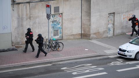 Police officers guard the area around the subway station.