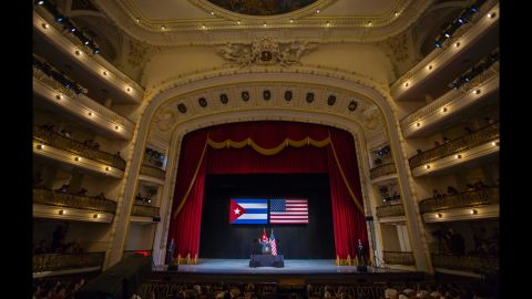 """Obama waves to the crowd before delivering his speech at the Grand Theater in Havana on March 22. In his speech, Obama urged Cubans to look to the future with hope, casting his historic visit as a moment to """"bury the last remnants of the Cold War in the Americas."""""""