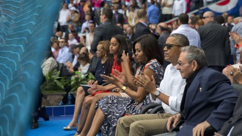 President Barack Obama, with his family, and Cuban President Raul Castro attend a exhibition baseball game between the Tampa Bay Rays and the Cuban National team at the Estadio Latinoamericano, Tuesday, March 22, in Havana, Cuba.