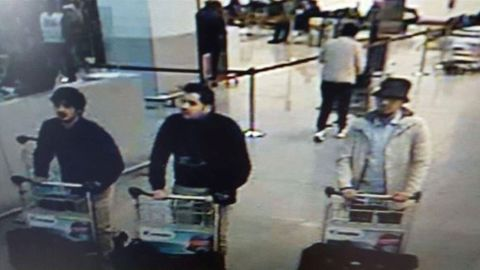 Police are after the man on the right in connection with the airport attacks.