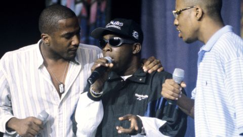 """Malik Taylor, better known to fans as <a href=""""http://www.cnn.com/2016/03/23/entertainment/phife-dawg-obit-feat/index.html"""" target=""""_blank"""">Phife Dawg</a> of the rap group A Tribe Called Quest, died March 23 at the age of 45. He's seen here at center during a performance in 1996. Taylor had long suffered from health issues associated with having Type 1 diabetes. In 2008, he underwent a kidney transplant."""