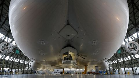The Airlander 10 airship is pictured airborne in its hangar during its media launch at Cardington Airfield in Shortstown near Bedford on March 21, 2016. The Airlander, which was originally developed for the US military, is 300 feet (91 metres) long, according its British maker Hybrid Air Vehicles. The Airlander is essentially three streamlined airship-type bodies merged into one with wings and rotary engines. / AFP / ADRIAN DENNIS        (Photo credit should read ADRIAN DENNIS/AFP/Getty Images)