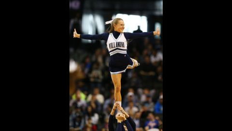 A Villanova cheerleader performs during a tournament game on Sunday, March 20.