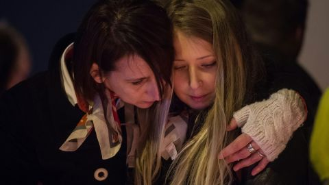 """Airport workers and their relatives in Brussels, Belgium, hold a candlelight vigil Wednesday, March 23, to pay tribute to those who were killed in <a href=""""http://www.cnn.com/2016/03/22/world/gallery/belgium-airport-explosion/index.html"""" target=""""_blank"""">terrorist attacks </a>the day before. On Tuesday, explosions rocked the city's airport and a subway station."""
