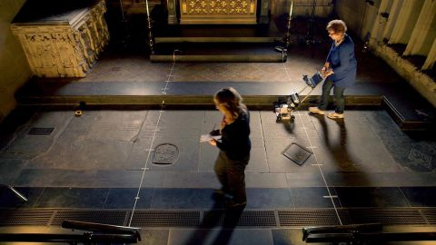 Archaeologists used radar scans to perform a non-invasive survey of William Shakespeare's grave. It is the smaller square stone to the right of the yellow tape measure lying on the floor.