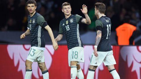 Toni Kroos celebrates scoring the opener for Germany in Berlin.