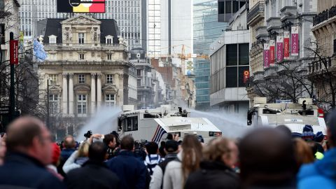 Police use water cannons to disperse anti-immigration protesters Sunday.