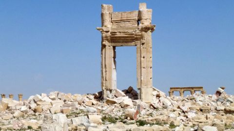 """A general view shows the remains of the entrance to the iconic Temple of Bel that was destroyed by Islamic State (IS) group jihadists in September 2015 in the ancient city of Palmyra, after government troops recaptured the UNESCO world heritage site from the IS group on March 27, 2016.                President Bashar al-Assad hailed the victory as an """"important achievement"""" as his Russian counterpart and key backer Vladimir Putin congratulated Damascus for retaking the UNESCO world heritage site. / AFP / Maher AL MOUNES        (Photo credit should read MAHER AL MOUNES/AFP/Getty Images)"""