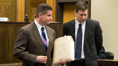 Attorney Daniel Herbert, left, leaves the courtroom with his client, Chicago police officer Jason Van Dyke. after a hearing in the Leighton Criminal Court Building on December 18, 2015 in Chicago, Illinois.