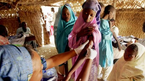 """According to the Director of Surveillance at the NCDC, Mrs Olubunmi Ojo, """"Immunisation is key to the prevention of meningitis.  Pictured: A woman is vaccinated against meningitis 17 March 2006 in Tchadoua near Maradi in South west Niger."""