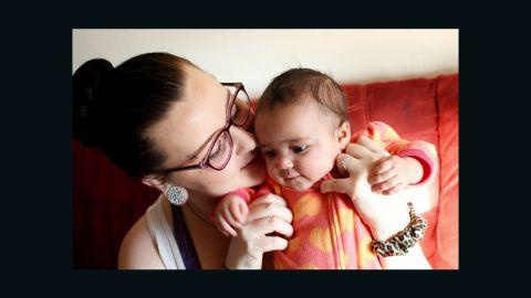 Amanda Hensley holds her daughter Valencia.