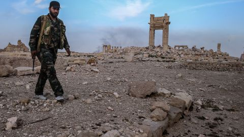 """<strong>After:</strong> A Syrian government soldier walks near what's left of the Temple of Baalshamin on Sunday, March 27. Syrian forces retook the city days before, but damage had already been done by ISIS. UNESCO says it plans to evaluate the extent of <a href=""""http://www.cnn.com/2016/03/28/middleeast/isis-palmyra-treasures-destroyed/index.html"""" target=""""_blank"""">Palmyra's damage</a> soon. Many of the structures -- which date from the first and second centuries and marry Greco-Roman techniques with local traditions and Persian influences -- remain in place, bolstering hopes that ISIS didn't completely raze the world heritage site."""