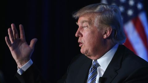 Donald Trump (L), chairman and president of The Trump Organization, speaks during a discussion at the Economic Club of Washington, December 15, 2014 in Washington, DC.