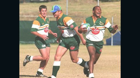 Chester Williams (right) was the first black player to represent the Springboks after the end of apartheid, and was an integral part of the title-winning side in 1995. The winger scored four tries in the quarterfinal win over Samoa.