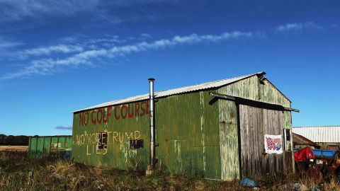 Here, Scottish folk touched by Trump's economic investment in their community, leave messages of thanks daubed on shed.