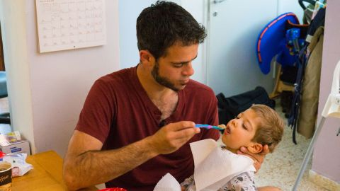 Asaf Parush administers medical cannabis oil to his son Lavie to treat his epilepsy.