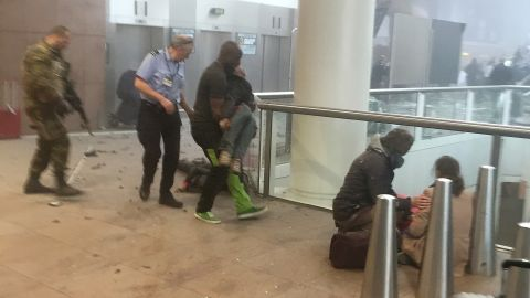 """Wounded passengers are treated following a suicide bombing at the Brussels Airport on March 22, 2016. <a href=""""http://www.cnn.com/2016/03/30/europe/brussels-investigation/index.html"""">The attacks on the airport and a subway </a>killed 32 people and wounded more than 300. ISIS claims its """"fighters"""" launched the attacks in the Belgian capital."""