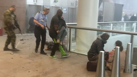 BRUSSELS, BELGIUM - MARCH 22:  Wounded passengers are treated following a suicide bombing at Brussels Zaventem airport on March 22, 2016 in Brussels, Belgium. Georgian journalist Ketevan Kardava, special correspondent for the Georgian Public Broadcaster, was travelling to Geneva when the attack took place, she was knocked to the floor and began to take photographs in the moments that followed. At least 31 people were killed and more than 260 injured in a twin suicide blast at Zaventem Airport and a further bomb attack at Maelbeek Metro Station. Two brothers are thought to have carried out the attacks and a manhunt is underway for a third suspect.   (Photo by Ketevan Kardava/Getty Images)